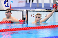 PICTURE BY ALEX BROADWAY /SWPIX.COM - 2012 London Paralympic Games - Day Two - Swimming - Aquatic Centre, Olympic Park, London, England - 31/08/12 - Sam & Oliver Hynd of Great Britain reacts after the Men's 400m Freestyle S8 Final.