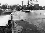 The spillway at Highland Lake in Winsted was the source of much worry. The lake waters flowed over the road and down the sluices and eventually into the Mad River, the scourge of Winsted's Main Street on August 19th.