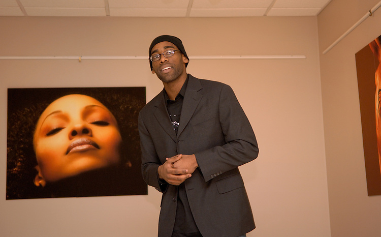 "Donald Black Jr.  03', Photography exhibit at the Lindley Cultural Center.216-835-8300.www.donaldblack.com. Talks to students  about his work.( Not wearing hat, has beard)..Shawn Wiliams is young actor/Ou Alum. Currently living in NYC as a professional actor. Feb 9th he performed a piece titles? Shape Shifter"" displaying the comparisons between NBA draft and the slave auction.(silhouette, no shirt in chains)..Performer Nyerre Mays, former O.U. student who recites a poem about his experience being in a shooting that happened in Athens when he was a student. (Wearing hat)"