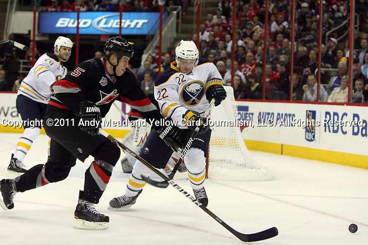 03 March 2011: Carolina's Bryan Allen (5) and Buffalo's Brad Boyes (22). The Carolina Hurricanes defeated the Buffalo Sabres 3-2 in overtime at the RBC Center in Raleigh, North Carolina in a 2010-2011 regular season National Hockey League game.