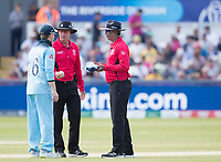 The umpires have a chat with Eoin Morgan (England) in respect of throwing the ball in on the bounce during England vs New Zealand, ICC World Cup Cricket at The Riverside Ground on 3rd July 2019