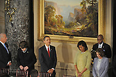 Washington, DC - January 20, 2009 -- Vice President Joseph Biden, United States Senator Diane Feinstein (Democrat of California), United States President Barack Obama, first lady Michelle Obama, and  Speaker of the House Nancy Pelosi during the invocation at the beginning of the luncheon at Statuary Hall in the United States Capitol in Washington DC following Barack Obama's swearing in as the 44th President of the United States on January 20, 2009..Credit: Amanda Rivkin - Pool via CNP