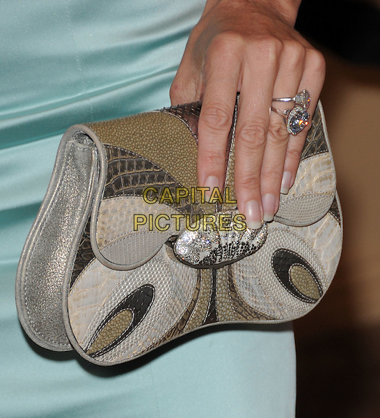 NICOLLETTE SHERIDAN'S BAG.The 2008 ABC Summer All Star Party held at Beverly Hilton Hotel in Beverly Hills, California on .July 17th, 2008    .hand ring finger  silver grey gray rings diamond nicolette beige jewel encrusted snakeskin .CAP/DVS.©Debbie VanStory/Capital Pictures.