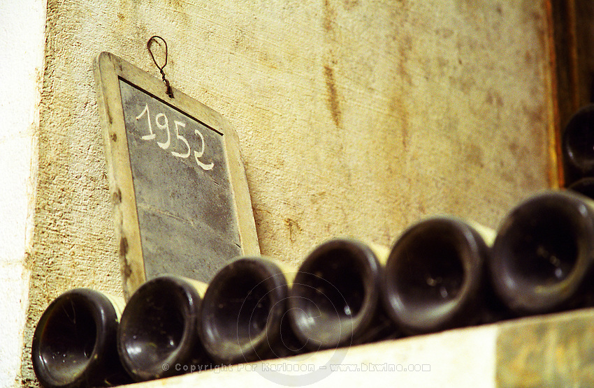 Bottles on a shelf with a chalk board with the vintage 1952 written on it  Chateau Mont-Redon, Chateauneuf-du-Pape Châteauneuf, Vaucluse, Provence, France, Europe