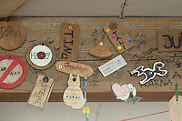 """Individual """"Keys"""" made by students for the """"In/Out"""" board, carpentry workshop, Summerhill School, Leiston, Suffolk. The school was founded by A.S.Neill in 1921 and is run on democratic lines with each person, adult or child, having an equal say.  You don't have to go to lessons if you don't want to but could play all day.  It gets above average GCSE exam results."""