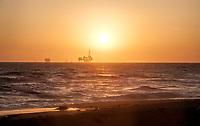 The sun sets on a spring day at Huntington Beach, California.
