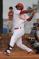 Johnson City Cardinals designated hitter Roberto De La Cruz #31 swings at a pitch during the first game of the 2011 Championship Series between the Bluefield Blue Jays and the Johnson City Cardinals at Howard Johnson Field on September 3, 2011 in Johnson City, Tennessee.  The Cardinals won the game 4-3.  (Tony Farlow/Four Seam Images)