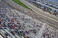 May 1, 2009; Richmond, VA, USA; NASCAR Nationwide Series fans look on as drivers race by during the Lipton Tea 250 at the Richmond International Raceway. Mandatory Credit: Mark J. Rebilas-