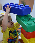 "Gunner, 3, builds a ""clubhouse"" out of large colored blocks while at Leslie Early Head Start childcare on October 11, 2013 in Hyden, Kentucky.  The daycare is funded entirely by the government, and could be in jeopardy if the government shutdown continues."