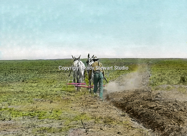 Jerome ID:  Plowing the farmland on the 160 acre homestead - 1909. Brady Stewart and three friends went to Idaho on a lark from 1909 thru early 1912.  As part of the Mondell Homestead Act, they received a grant of 160 acres north of the Snake River.  Brady Stewart photographed the adventures of farming along with the spectacular landscapes. To give family and friends a better feel for the adventure, he hand-color black and white negatives into full-color 3x4 lantern slides.  The Process:  He contacted a negative with another negative to create a positive slide.  He then selected a fine brush and colors and meticulously created full color slides.