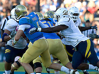 D.J. Holt of California sacks UCLA quarterback Kevin Prince during the game at Rose Bowl in Pasadena, California on October 29th, 2011.  UCLA defeated California, 31-14.