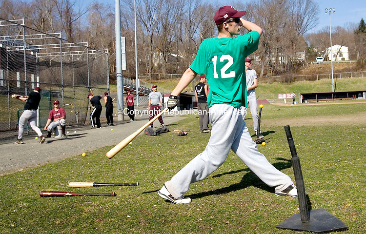 NAUGATUCK, CT. 19 March 2012-031912SV09-Adam Neveski, 17, of Naugatuck watches a long hit while doing a batting drill during the first day of tryouts at Naugatuck High School in Naugatuck Monday..Steven Valenti Republican-American