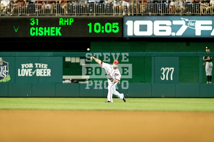 Washington Nationals outfielder Bryce Harper (34) fields a fly ball during a game against the Miami Marlins at Nationals Park in Washington, DC on September 7, 2012.