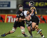 Taranaki's Craig Clarke and Jayden Hayward tackle Jamie Helleur. Air New Zealand Cup rugby match - Taranaki v Auckland at Yarrows Stadium, New Plymouth, New Zealand. Friday 9 October 2009. Photo: Dave Lintott / lintottphoto.co.nz