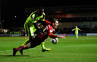 Lincoln City's Harry Toffolo is fouled by Bolton Wanderers' Aristote Nsiala<br /> <br /> Photographer Chris Vaughan/CameraSport<br /> <br /> The EFL Sky Bet League One - Lincoln City v Bolton Wanderers - Tuesday 14th January 2020  - LNER Stadium - Lincoln<br /> <br /> World Copyright © 2020 CameraSport. All rights reserved. 43 Linden Ave. Countesthorpe. Leicester. England. LE8 5PG - Tel: +44 (0) 116 277 4147 - admin@camerasport.com - www.camerasport.com