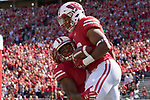 Wisconsin Badgers running back Jonathan Tayler (23) celebrates a touchdown with a teammate during an NCAA College Football game against the Florida Atlantic Owls Saturday, September 9, 2017, in Madison, Wis. The Badgers won 31-14. (Photo by David Stluka)