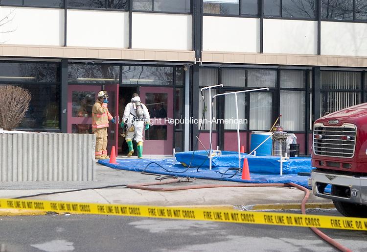 TORRINGTON, CT- 07 MARCH 07- 030707JT03- <br /> Torrington firefighters enter Torrington High School Wednesday after a small mercury spill at the school.<br /> Josalee Thrift Republican-American