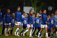 Kansas City, MO - Friday May 13, 2016: FC Kansas City players including midfielders Yael Averbuch (10), Heather O'Reilly (9), and Mandy Laddish (7) enter the field for pre-game introductions. FC Kansas City and the Chicago Red Stars played to a 0-0 tie during a regular season National Women's Soccer League (NWSL) match at Swope Soccer Village.