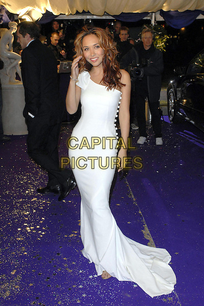 MYLEENE KLASS .at the British Comedy Awards 2006, London Television Studios, London, UK. December 13th, 2006 .full length white dress long maxi train one shoulder buttons hand .CAP/FIN.©Steve Finn/Capital Pictures.