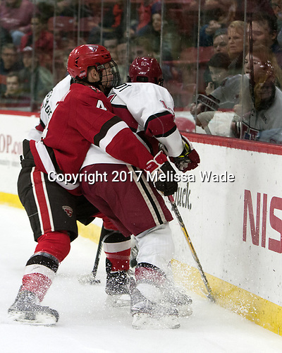 Mike Graham (SLU - 4), Alexander Kerfoot (Harvard - 14) - The Harvard University Crimson defeated the St. Lawrence University Saints 6-3 (EN) to clinch the ECAC playoffs first seed and a share in the regular season championship on senior night, Saturday, February 25, 2017, at Bright-Landry Hockey Center in Boston, Massachusetts.