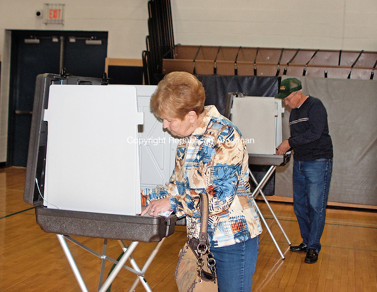 WOLCOTT- NOVEMBER 042014 110414DA04- Germaine Pelletier, of Wolcott casts her vote along side of her husband James at Tyrrell Middle School on Tuesday. <br /> Darlene Douty Republican American