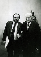 Milan, Italy. Umberto Eco, Italian semiologist and writer with Alberto Moravia, Italian writer.