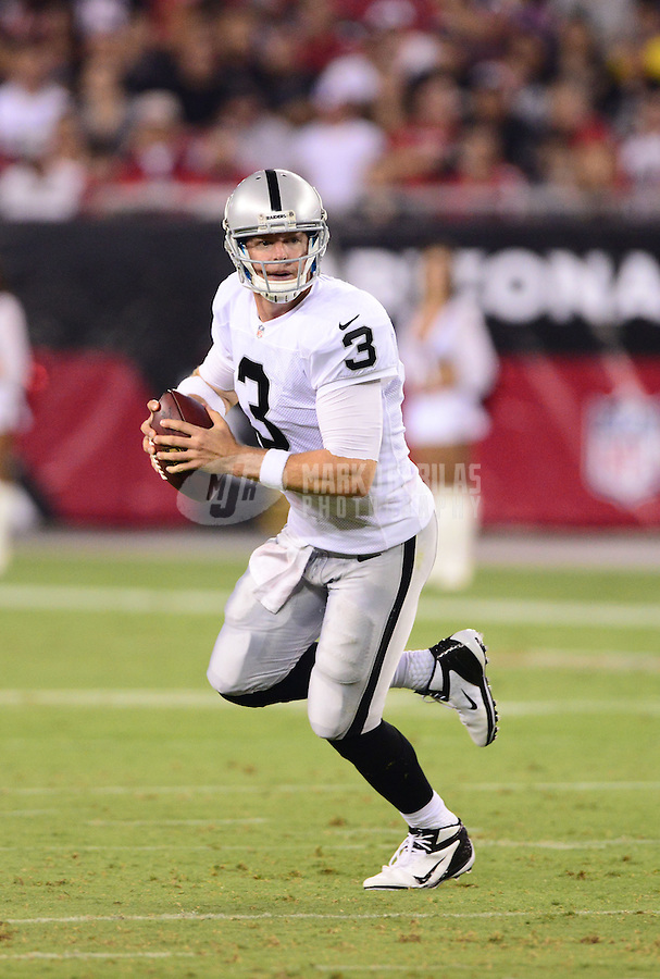Aug. 17, 2012; Glendale, AZ, USA; Oakland Raiders quarterback (3) Carson Palmer against the Arizona Cardinals during a preseason game at University of Phoenix Stadium. The Cardinals defeated the Raiders 31-27. Mandatory Credit: Mark J. Rebilas-