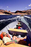 Sig Woman a motor boat in The Lake Povel water resavour behind Glen Canyon Dam, Utah, USA