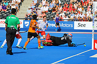 Malaysian goalie Kumar Subramiam watches as Englands Sam Ward scores Englands 6th goal during the Hockey World League Semi-Final Pool A match between England and Malaysia at the Olympic Park, London, England on 17 June 2017. Photo by Steve McCarthy.