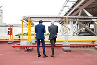 Architects Norman Foster and Fernando Romero waiting for their helicopter at the Camino Real hotel, Mexico City.