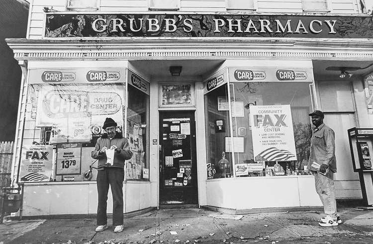 People at Grubbs Pharmacy in November 1992. (Photo by Maureen Keating/CQ Roll Call via Getty Images)