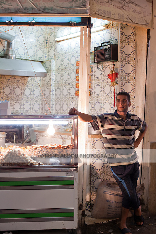 A man sells pastries in the Tunis Medina (old city).  The Medina of Tunis, Tunisia is a UNESCO World Heritage Site.