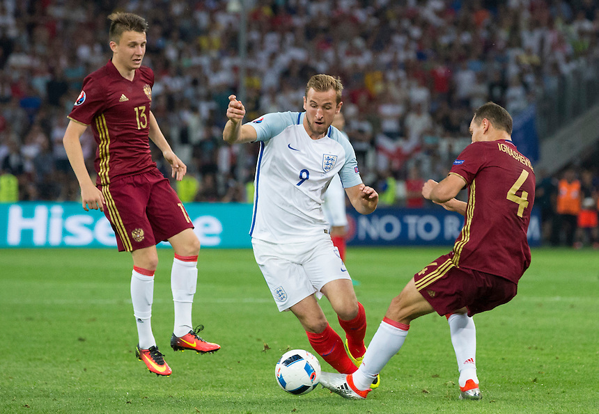 England's Harry Kane is fouled by Russia's Sergei Ignashevich<br /> <br /> Photographer Craig Mercer/CameraSport<br /> <br /> International Football - 2016 UEFA European Championship - Group B - England v Russia - Saturday 11th June 2016 - Stade Velodrome, Marseille - France <br /> <br /> World Copyright &copy; 2016 CameraSport. All rights reserved. 43 Linden Ave. Countesthorpe. Leicester. England. LE8 5PG - Tel: +44 (0) 116 277 4147 - admin@camerasport.com - www.camerasport.com