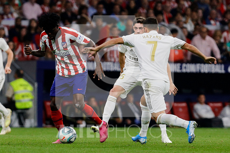 Thomas Teye of Atletico de Madrid and Eden Hazard of Real Madrid during La Liga match between Atletico de Madrid and Real Madrid at Wanda Metropolitano Stadium{ in Madrid, Spain. {iptcmonthname} 28, 2019. (ALTERPHOTOS/A. Perez Meca)