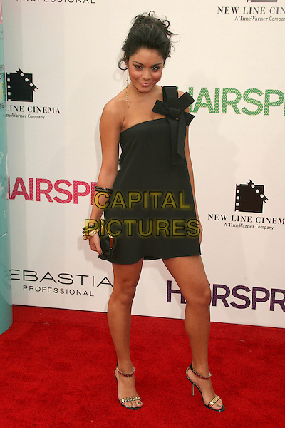 """VANESSA HUDGENS.""""Hairspray"""" Los Angeles Premiere at Mann's Village Theatre, Westwood, California, USA..July 10th, 2007.full length dress one shoulder black bow one earrings dangling bracelets clutch purse gold .CAP/ADM/BP.©Byron Purvis/AdMedia/Capital Pictures"""