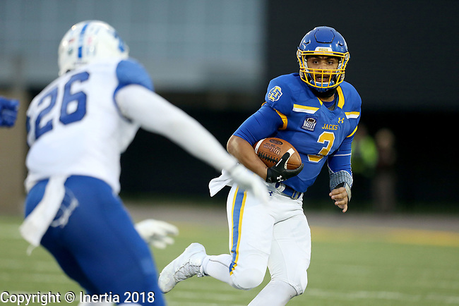 BROOKINGS, SD, OCTOBER 6: Taryn Christion #3 from South Dakota State University eyes the defense of Darrick Webster #26 from Indiana State during their game Saturday night at Dana J. Dykhouse Stadium in Brookings. (Dave Eggen/Inertia)