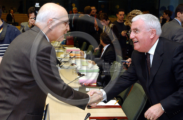 Brussels-Belgium - December 20, 2004---European Ministers for Environment meet at the 'Justus Lipsius', seat of the Council of the European Union in Brussels; here, Stavros DIMAS (le), European Commissioner in charge of Environment, with Dick ROCHE (ri), Minister of Environment of Ireland, at the beginning of the meeting---Photo: Horst Wagner/eup-images