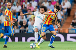 Carlos Soler Barragan (r) of Valencia CF fights for the ball with Marcelo Vieira Da Silva of Real Madrid during their La Liga 2017-18 match between Real Madrid and Valencia CF at the Estadio Santiago Bernabeu on 27 August 2017 in Madrid, Spain. Photo by Diego Gonzalez / Power Sport Images