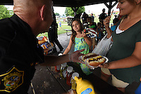 NWA Democrat-Gazette/J.T. WAMPLER The Springdale Police Department Tuesday Aug. 4, 2015 at Murphy Park in Springdale during the National Night Out. The event was part of a national campaign to build trust between police officers and city residents. The event featured free food, music, police and fire vehicles on display, contests and a movie. The Springdale police department joined more than 16,000 law agencies nationwide to participate in the campaign.<br />