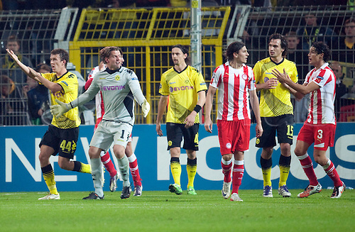 01.11.2011 Dortmund, Germany.  Dortmund's goalkeeper Roman Weidenfeller (2-L) shouts during the UEFA Champions League group F soccer match between Borussia Dortmund and Olympiacos Piraeus at the Signal-Iduna-Park stadium in Dortmund, Germany. Mandatory credit: ActionPlus