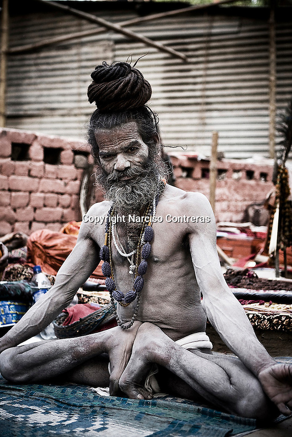 KUMBH MELA. THE NAGA BABAS PROCESSION. A SADHU GURU DURING THE RELIGIOUS MEETING WHERE MORE THAN 20 MILLION DEVOTEES ATTEND IT IN HARIDWAR, INDIA.
