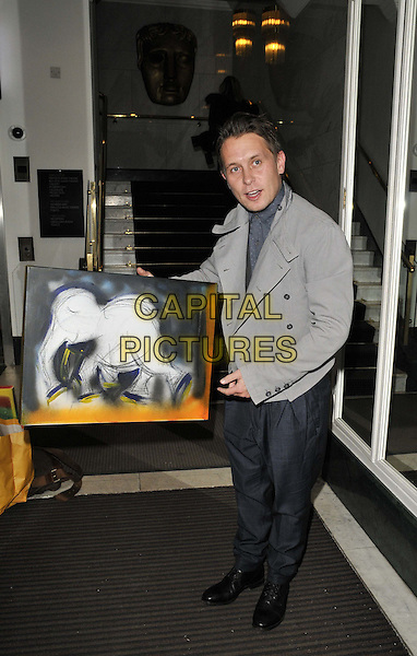 Mark Owen.The TUSK Modern charity auction & reception, BAFTA, Piccadilly, London, England..December 5th, 2011.full length take that grey gray jacket blue trousers elephant painting holding .CAP/CAN.©Can Nguyen/Capital Pictures.