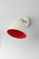 One of a pair of red and white wall lights