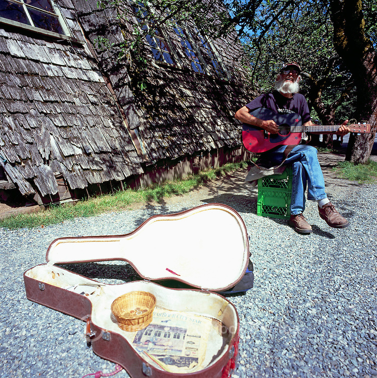 Coombs, BC, near Parksville, Vancouver Island, British Columbia, Canada - Reverend Bill Julsing playing his guitar (No Model or Property Release)