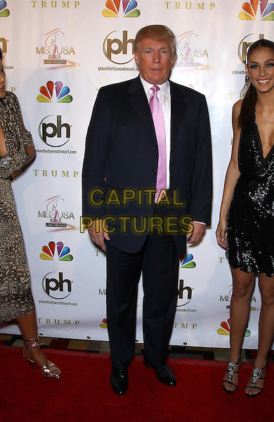 Donald Trump.2012 Miss USA Pageant red carpet arrivals at Planet Hollywood Resort and Casino, Las Vegas, Nevada, USA..3rd June 2012.full length black suit pink tie white shirt .CAP/ADM/MJT.© MJT/AdMedia/Capital Pictures.