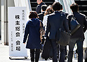 March 27 2015, Tokyo, Japan - Stockholders arrive in groups of twos and threes for the annual shareholders meeting of Japan's leading furniture reail chain Otsuka Kagu Ltd. in Tokyo on Friday, March 27, 2015. A feud between the founder-chairman Katsuhisa Otsuka and his daughter-president Kumiko Otsuka over the corporate governance has resulted in a proxy fight between the two, with the result expected to decide the fate of the badly shaken furniture giant.  (Photo by Natsuki Sakai/AFLO)