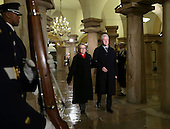 Former United States President Bill Clinton and U.S. Secretary of State Hillary Rodham Clinton walk through the crypt on their way to watch US President Barack Obama be sworn-in for a second term along with President Barack Obama, by Supreme Court Chief Justice John Roberts during his public inauguration ceremony at the U.S. Capitol Building in Washington, D.C. on January 21, 2013.      .Credit: Molly Riley / Pool via CNP