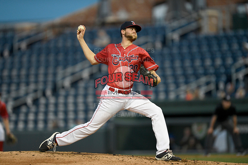 Starting pitcher Hunter Haworth (20) of the Greenville Drive, playing as the Energia in MiLB's Copa de la Diversion, delivers a pitch in a game against the Augusta GreenJackets at Fluor Field at the West End in Greenville, South Carolina. Augusta won, 9-8. (Tom Priddy/Four Seam Images)