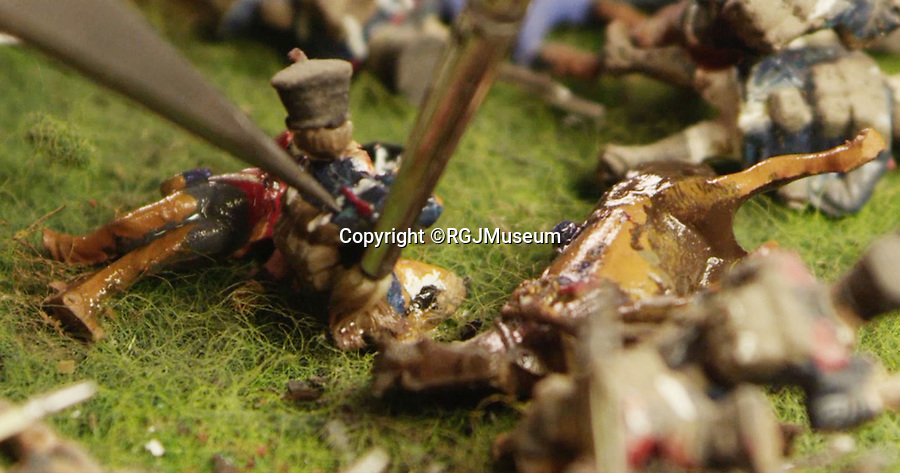 BNPS.co.uk (01202 558833)<br /> Pic: RGJMuseum/BNPS<br /> <br /> Each figure has been individually cleaned.<br /> <br /> Historic battle brought back to life...<br /> <br /> A stunning diorama of the battle of Waterloo has been restored to its former glory after a painstaking cleaning operation to remove nearly 50 years of dust.<br /> <br /> The sweeping panorama contain's 21,500 figures and nearly 10,000 horses, each of which has been meticulously cleaned by hand over the last five months by husband and wife team Kelvin and Mary Thatcher from Norfolk.<br /> <br /> The pristine model has now gone back on display at the refurbished Royal Green jackets museum in Winchester.<br /> <br /> A sobering fact is that there were over twice as many casualties in the actual battle as there are figures on the diorama.