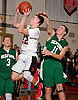 Joseph Santoro #22 of Island Trees attempts to drive past Andrew Pich #11  of Seaford during a Nassau County varsity boys' basketball game at Island Trees High School on Wednesday, Jan. 13, 2016. Island Trees won by a score of 63-48.
